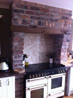 cooker surround constructed  reclaimed bricks  oak