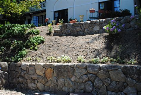 retaining wall on steep slope retaining walls the new stone age