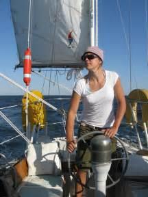 Woman On Sailboat Sailing