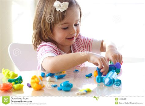 Girl Playing With Play Dough Stock Photo  Image 12850422