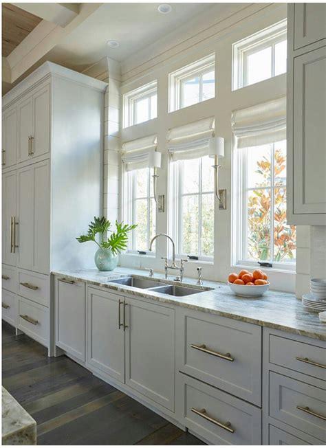 Lining Kitchen Cupboards by Satin Nickel Pulls White Romans Quartz Countertops