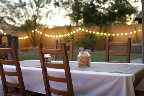 outdoor wood wedding dining table with white fabric cover