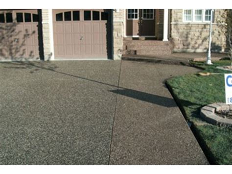 concrete driveways are the solution to cracked asphalt