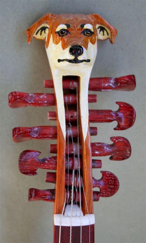dog head hardanger fiddle violin scroll  images