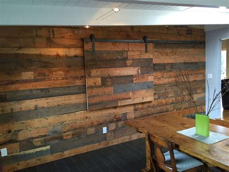 reclaimed fir shiplap wall  hidden tv slider cabinetry