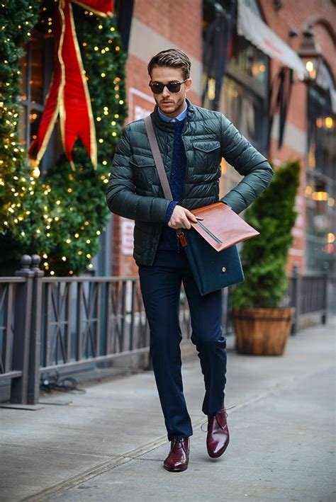 Picture Of navy trousers a navy pullover and rich brown shoes