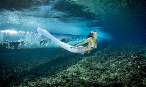 A Photographer Has Captured Models Swimming Through The