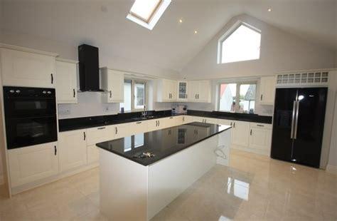 image  white gloss kitchens  black worktops