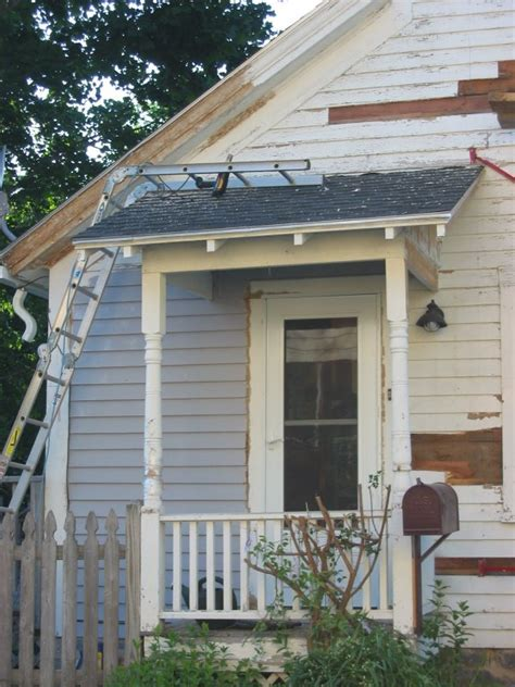 side porches flowering vine trellis at front porch door topper done side still needed to be added so