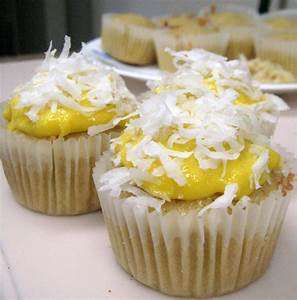 Coconut Cupcakes with Mango Curd Filling | Much Ado About Pie