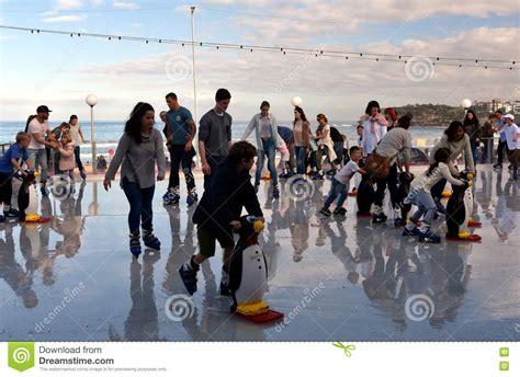 people are ice skating on bondi ice rink editorial