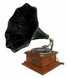 Collector turning up the volume on antique phonographs