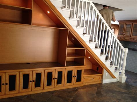 showcase designs below staircase solution for open space under staircase this is double sided with entertainment center on one