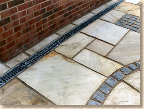 concrete patio on slope using a linear channel drain