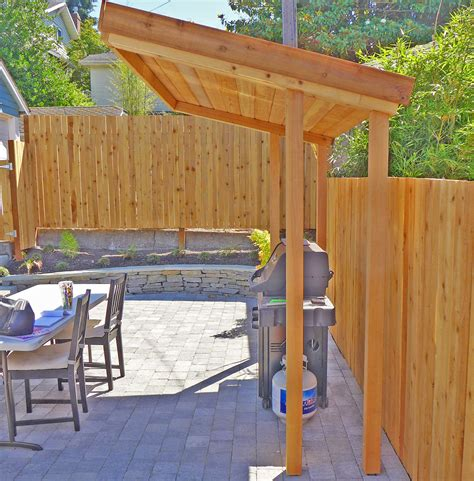 covered outdoor bbq area bryant backyard seattle landscape design