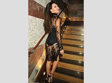 Lizzie Cundy flaunts her pert posterior with a bevy of