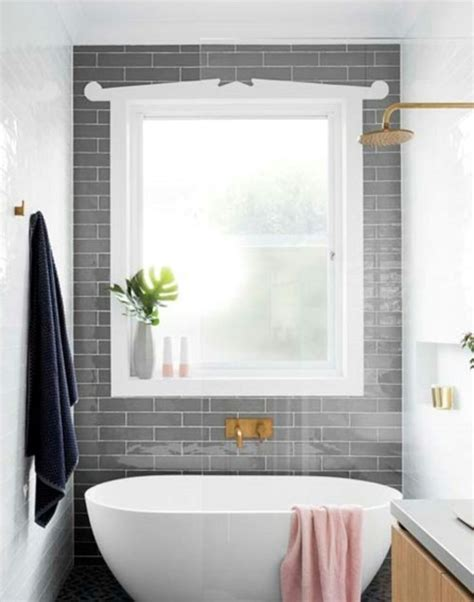 grey subway feature tiles  bathroom window