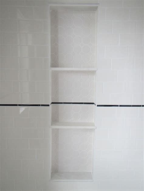 bathroom reno shower nichealcove  hexagon tile