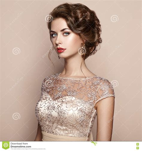 Fashion Portrait Of Beautiful Woman In Elegant Dress Stock