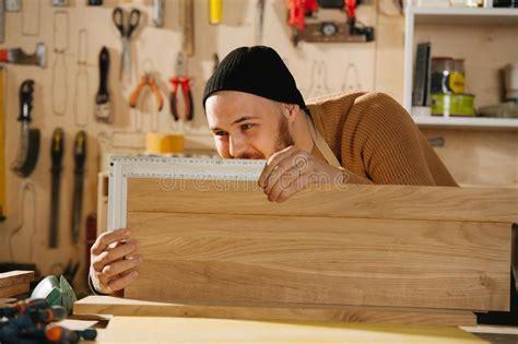 carpenter making furniture stock image image  carpentry