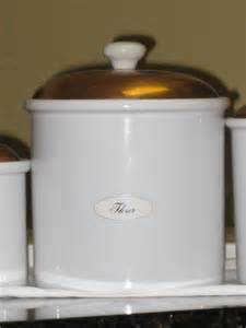 White Kitchen Canisters Set Of Three Ceramic White Canisters W Copper Lids