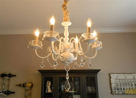 update a brass chandelier with white paint fabric and