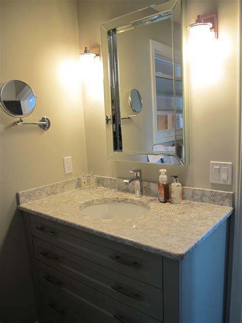 grey painted bathroom  subtle gold hardware woodecor