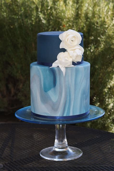 Blue Tiered Marbled Wedding Cake With White Roses Just