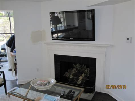tv above fireplace where to put components middlefield ct tv above fireplace relocation of cable