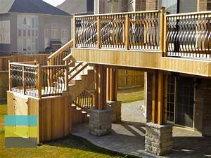 2 level cedar deck with wrought iron railings, pergola and