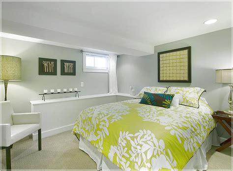 basement bedroom   simple color scheme basement