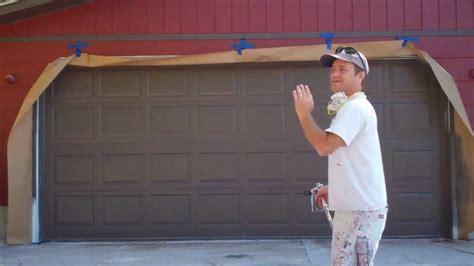black garage doors painting a garage door