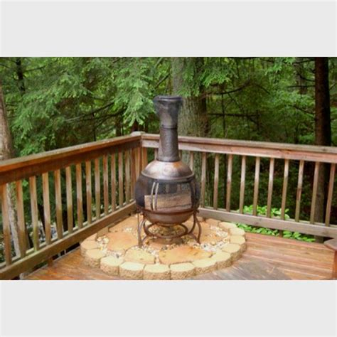 Is It To Burn Wood In Backyard by Great Idea To Put Your Chiminea So It Doesn T Burn