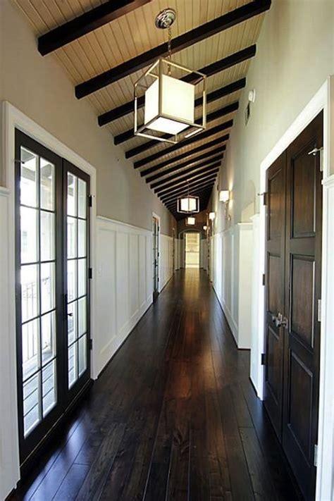 suzie long narrow corridor  glossy dark chocolate brown hardwood floors  espresso
