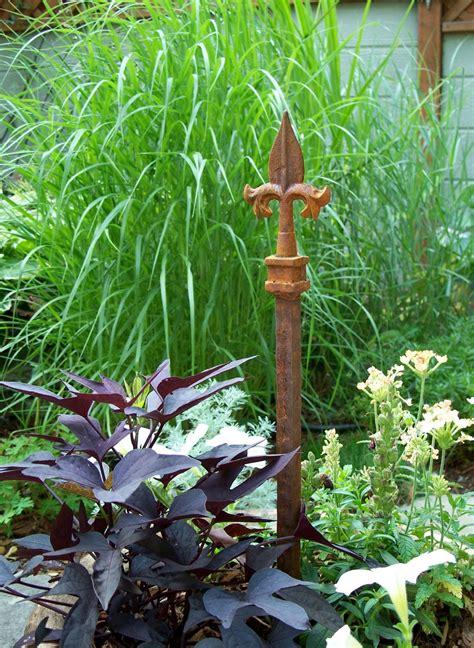 decorative garden stakes steel garden stake garden decor unique hose guide