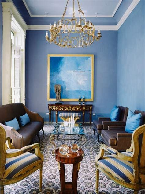Color blocking with misty blue, brown, and ivory creates a visually stimulating appeal. light blue walls, dark brown, minor jewel tones, big pattern   Blue living room decor, Blue ...