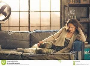 An Elegant Brunette Woman Wearing Comfortable Stock Photo