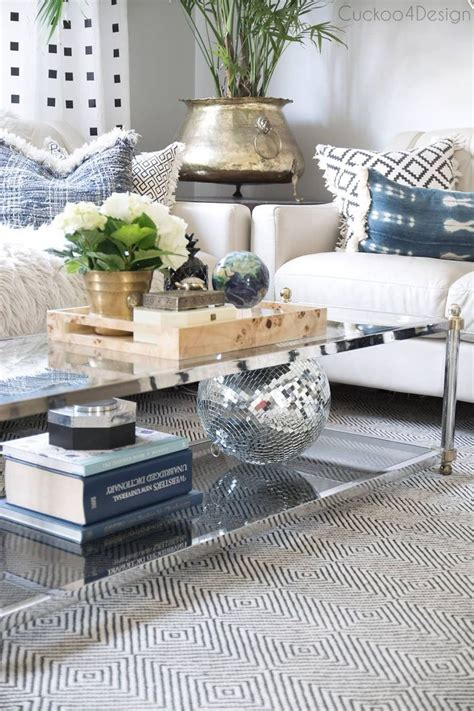 Coffee tables are often the centerpiece of the living room. Ideas for Coffee Table Decor Elegant How to Style A Two Tier Coffee Table   Table decor living ...