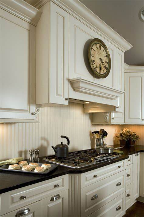 picture of cabinet in the kitchen is the backsplash beadboard painted to match the ivory 9097