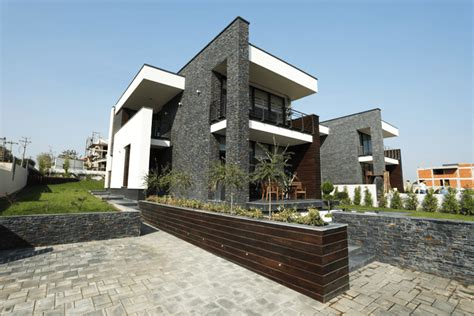 A Simple Modern Home With A Lot Of Personality Is For A And Their by Luxurious Contemporary Houses In Romania Europe