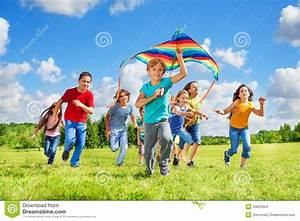Boys and girls with kite stock photo. Image of green ...