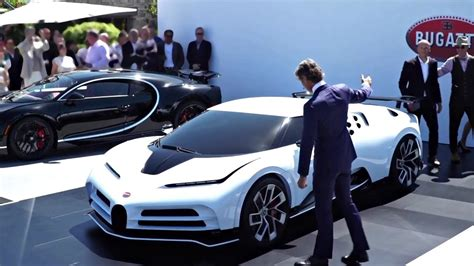 The rear end features a very complex design language which is accentuated by the huge wing. 2020 Bugatti Centodieci. $9m Supercar. 1600-Hp. (Unveiling) - CMC distribution English
