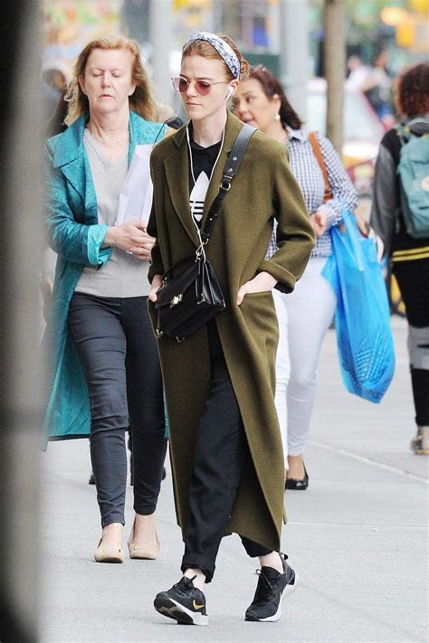 rose leslie steps out in an olive green trench coat with ...