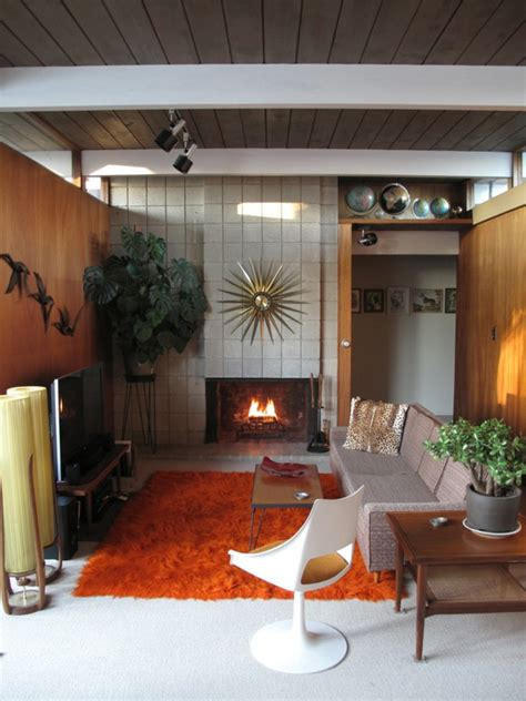 Troy rearranges his collections in his new Eichler ranch