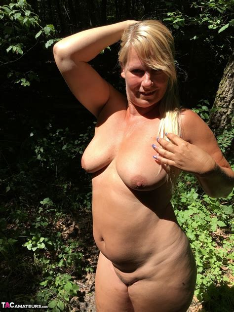 fatty mature susi spreading naked big ass while romping nude in the woods