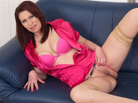 Mature Brunette Undressing And Pleasuring Herself On