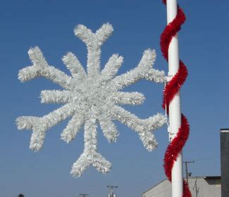 garland snowflake pole mounted decor commercial