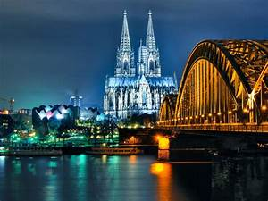 Cologne Cathedral And Hohenzollern Bridge At Night-Desktop