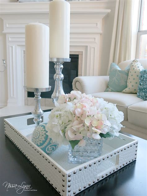 Or perhaps you've been considering options for something fresh and new, like upcycling that quirky object you found recently? Nissa-Lynn Interiors: Holiday Coffee Table Decor