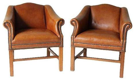 distressed camel leather club chairs a pair